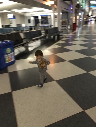 Fluffy was pretty psyched to be off the plane, and have the whole terminal to herself.